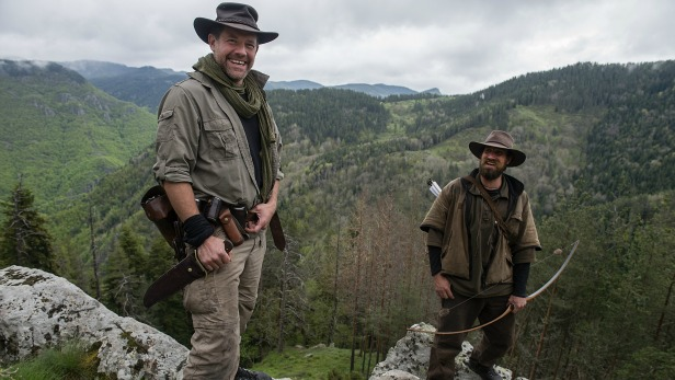 Kings Of The Wild Episode: Bulgaria  Matt Tebbutt (left) and Josh James are posing on a cliff overlooking the Izvore Hunting Estate