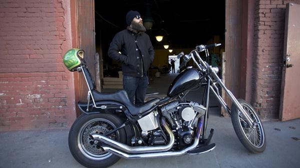 Jason standing behind his bike.